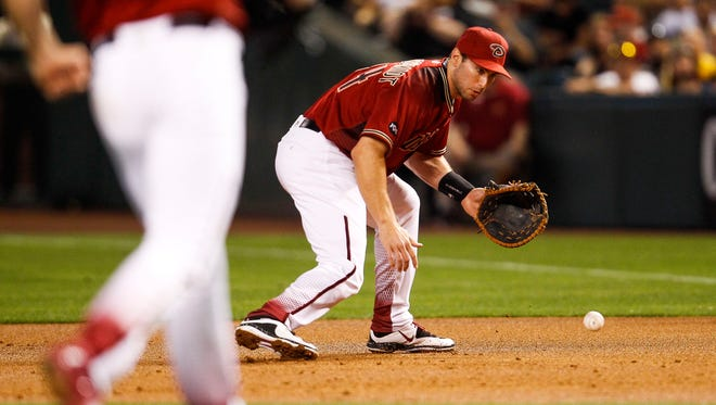 Arizona Diamondbacks' Paul Goldschmidt attempts to field a ground ball at first base against the Pittsburgh Pirates on Sunday, April 24, 2016, at Chase Field in Phoenix, Ariz. Goldschmidt committed an error on the play.