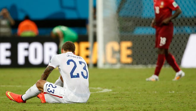 United States defender Fabian Johnson (23) sits on the ground.
