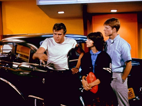 """Where were you in '62?"" So goes the tagline for 1973's ""American Graffiti,"" which stars Paul Le Mat (left), Cindy Williams and Ron Howard."