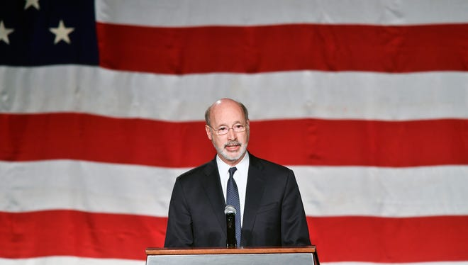 Pennsylvania Governor Tom Wolf speaks at a public memorial service honoring York City firefighters Ivan Flanscha and Zachary Anthony Wednesday, March 28, 2018, at the York Expo Center. Flanscha and Anthony were killed in the line of duty Thursday, March 22, 2018, while containing hot spots the day after a three-alarm fire consumed the old Weaver Organ and Piano building in York.