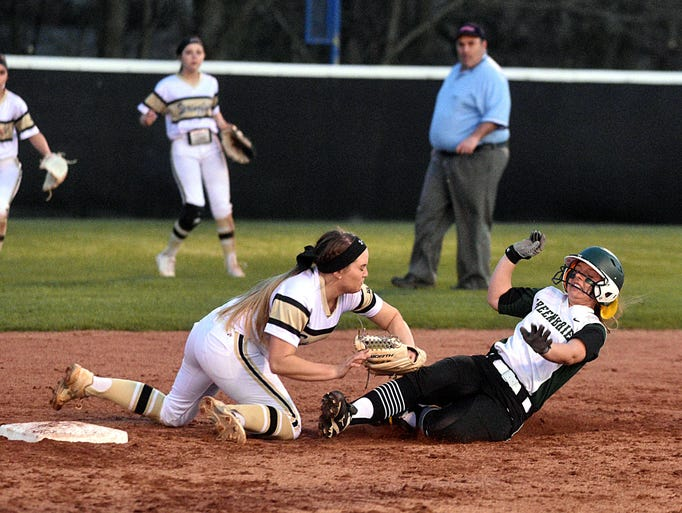 Springfield's Morgan Clark tags out Greenbrier's Abbi