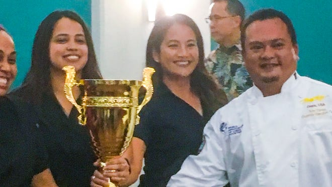Peter Duenas, right, owner and chef of Meskla Chamoru Fusion Bistro, accepts the Judges Cup Champion Pastry Award at Pastries in Paradise on Thursday, Feb. 22, 2018. Proceeds from the competition benefited the Guam Museum Foundation, Micronesian Chefs Association and Lend-A-Hand.