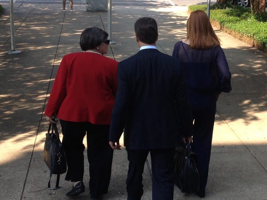 Investigator Mary Jane Marcental, attorney Michael Reese Davis and Barbie Hart leave the Ouachita Parish Courthouse after Tuesday's proceedings.