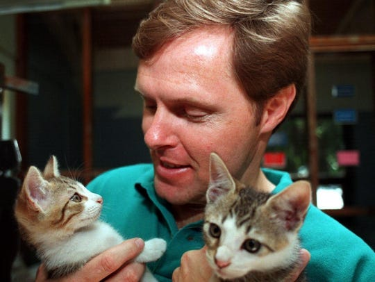 Lee Peterson clowns around with kittens at the Humane