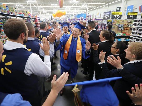 The procession line of Walmart graduates make their