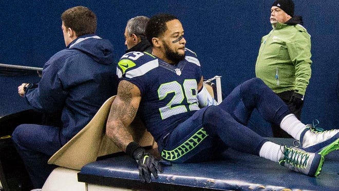 Seattle Seahawks free safety Earl Thomas (29) is taken off the field after getting injured during the second quarter in a game against the Carolina Panthers at CenturyLink Field.