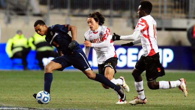 Former Aquinas star and Rochester native, Jordan Allen (left), shown here playing last December in the NCAA semifinals for the University of Virginia, made his MLS debut on Saturday night for Real Salt Lake.
