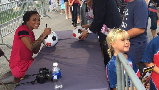 U.S. and WNY Flash forward Sydney Leroux, who is injured, signed autographs for 45 minutes before the match on Aug. 29, 2015.