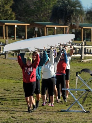 Members of the Pensacola Rowing Club get ready for a row across Bayou Texar Saturday morning. The group is helping to put together the first International Coastal Rowing tournamnet in the United States at Pensacola Beach.