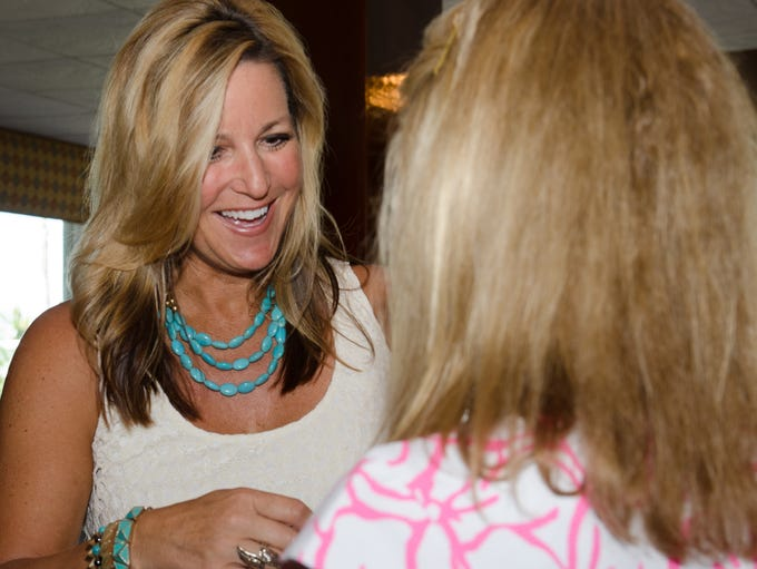Sharon Bean shows some jewelry to ladies at an event for the Hacienda Women's Guild on Sep. 26 at the Eau Gallie Yacht Club. (  Entertainment )
