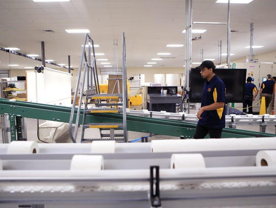 Nicolas Cordova, an employee at the toilet paper manufacturing
