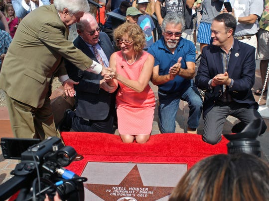 Palm Springs Walk of Stars president Bob Alexander compliments Kay Adkins after Huell Howser's star was unveiled in October 2015. Adkins began the efforts to raise money to pay for Howser's star campaign.