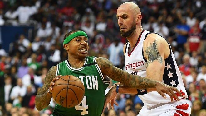 Boston Celtics guard Isaiah Thomas dribbles past Washington Wizards center Marcin Gortat during the second quarter in Game 4.