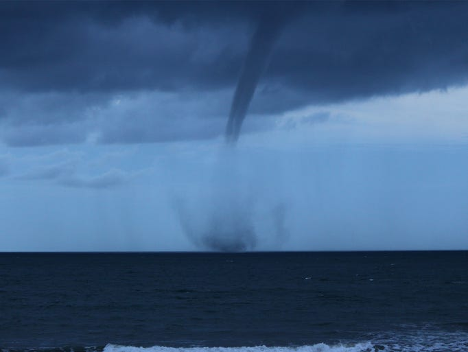 A fully-developed waterspout formed near Patrick Air Force Base on Thursday, July 11, 2014.