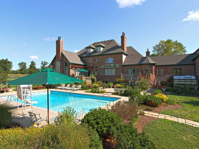 Upon entering the gate at 3290 S. U.S. 421, Zionsville, visitors feel like they are at a resort. Wooded grounds lead up to the 13,001-square-foot home that features an indoor basketball court, pool and horse barn.