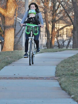 A Vox caller would like to see more bikers use the bike lanes and stay off the sidewalks.