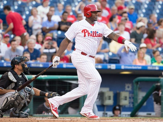 FILE - In this July 21, 2016, file photo, Philadelphia Phillies' Ryan Howard bats during the team's baseball game against the Miami Marlins in Philadelphia. The Colorado Rockies have agreed to a minor league contract with  Howard, who will report to Triple-A Albuquerque. Ryan, 37, hasn't played in the majors this season but could be a September call-up if he shows some power at the plate. He would be eligible for the postseason roster if the Rockies qualify for the playoffs. (AP Photo/Chris Szagola, File)