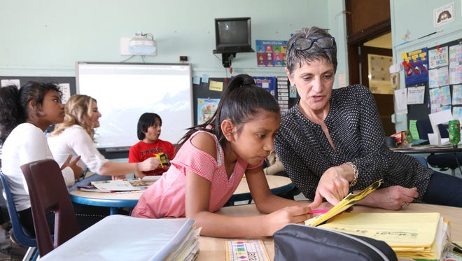At right, speech pathologist Domenique Canino works with her student, Catalina Lopez during an after school program at Warring Elementary School in the City of Poughkeepsie on May 8, 2018.