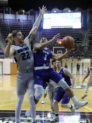 ACU's Tevin Foster, right, drives against Central Arkansas'