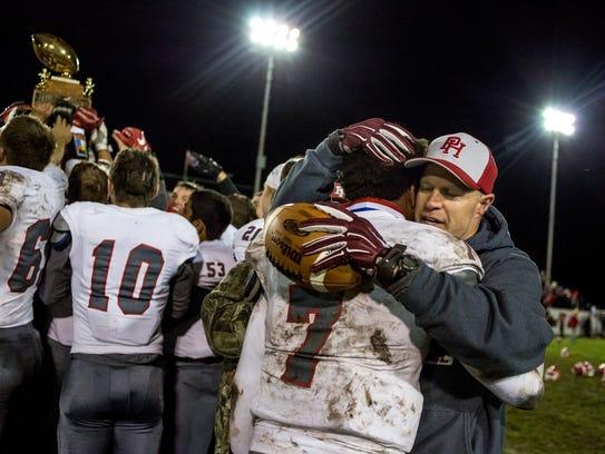 Port Huron's DeAngielo Sanderson Jr hugs coach Ryan