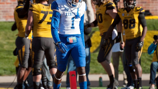 Kentucky safety A.J. Stamps walks to the sideline as Missouri teammates celebrate behind after they scored a touchdown during the second quarter of an NCAA college football game Saturday, Nov. 1, 2014, in Columbia, Mo. (AP Photo/L.G. Patterson)
