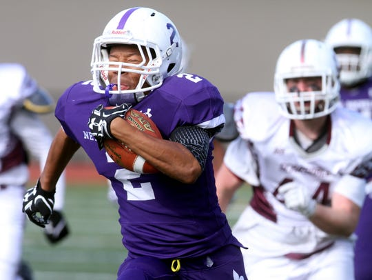 New Rochelle's Romeo Holden rushes during the Section