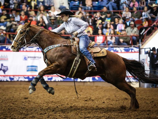 Tyra Kane races the barrels during the 8th performance of the San Angelo Stock Show and Rodeo Sunday, Feb. 11, 2018, at Foster Communications Coliseum.