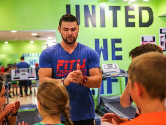 Matt Cutrer instructs students during a youth training