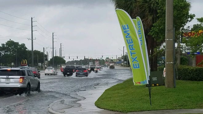 Roads were flooding on U.S. 1 at Jensen Beach Boulevard in Martin County on Wednesday, May 16, 2018.