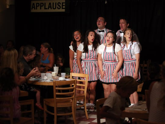 The cast performs at The Music Man Singing Ice Cream Shoppe in Lavallette. The shop is closed for the season but will present a handful of seasonal shows before reopening next spring.