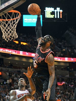 A mask didn't slow LeBron James on this one-handed jam.