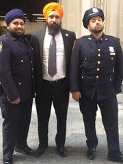Surjit  Singh, center, with brothers Inderjit Singh, L, and Pargat Singh, R, of the N.Y.P.D.