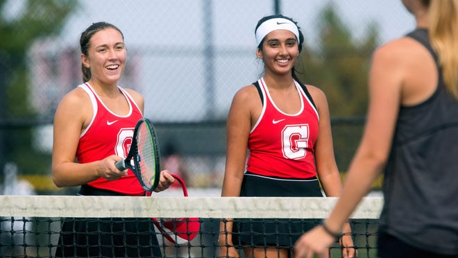 Amber Ehrlich, left, and Simmi Mander are all smiles after defeating U-High to claim the doubles title during the 2020 Girls CS8 Tennis Tournament at Glenwood High School Saturday, Oct. 10, 2020.