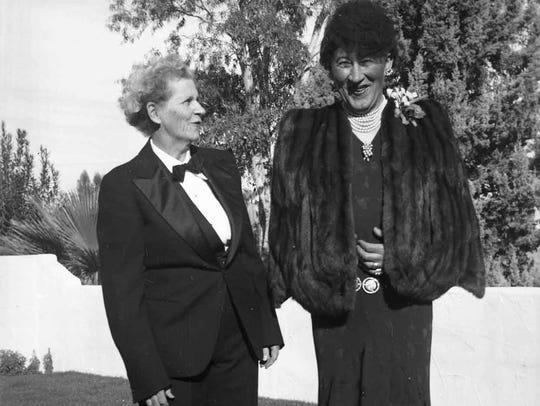 Carl Lykken in drag with unidentified woman.
