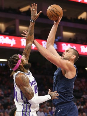 Memphis Grizzlies center Marc Gasol, right, shoots over Sacramento Kings center Willie Cauley-Stein during the first quarter of an NBA basketball game Wednesday, Oct. 24, 2018, in Sacramento, Calif. (AP Photo/Rich Pedroncelli)