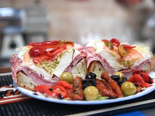 A sandwich brimming with cold cuts and fresh mozzarella at M & P Biancamano.