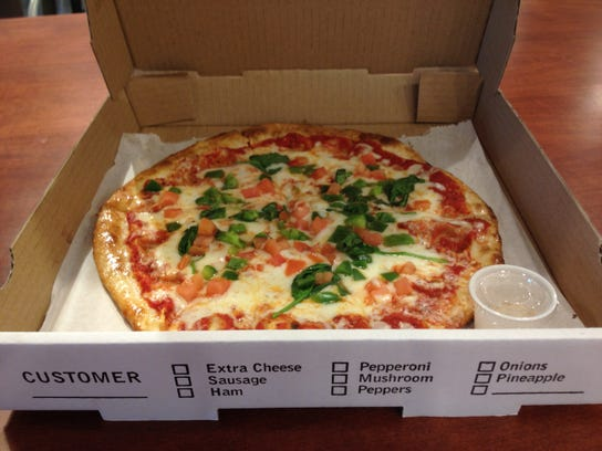 Topp N' Pie pizzas are made fresh and served on the