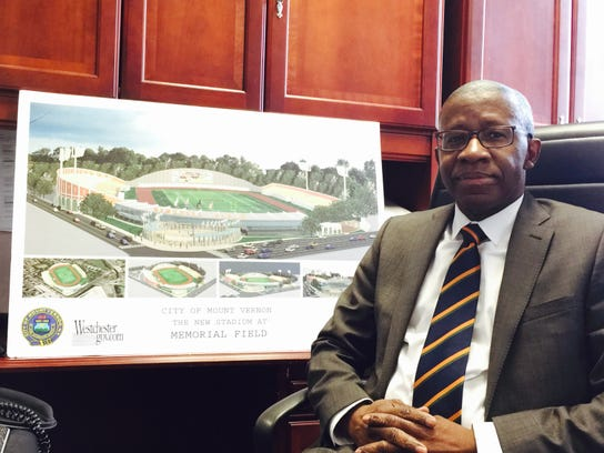 Westchester County Legislator Lyndon Williams with a rendering of the original Memorial Field renovation. Williams is proposing the county take the lead to finally reopen the iconic field in Mount Vernon.