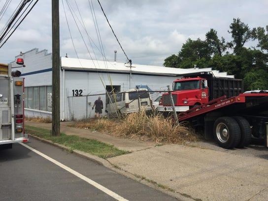 A van crashed into a cinder block building on College