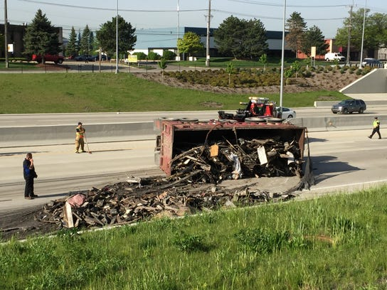 A truck spilled its load Friday morning onto westbound