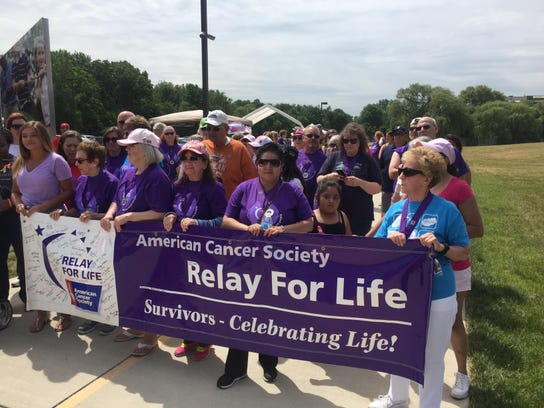 Cancer survivors and caregivers line up for the traditional