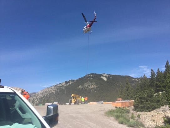 Crews used helicopters to transport some of the material