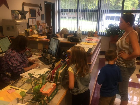 The office was a busy place on the first day of school.