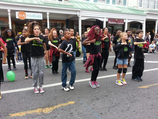 Dancers from the Center4 Creative Education strut their