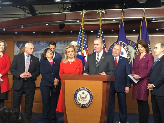 Reps. Debbie Dingell, D-Dearborn, and Tim Walberg, R-Tipton, center, promote their bill Jessie's Law during a January news conference at the U.S. Capitol.