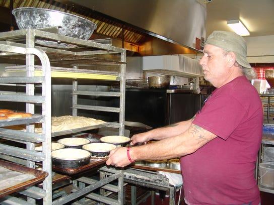 David Smith prepares cheesecakes at the Cheez-Kake