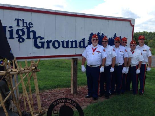Marines at the High Ground sign close.JPG