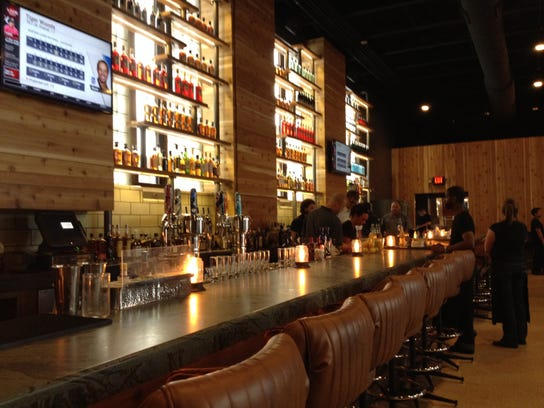 Comfortable seating makes dining at the bar an enticing option at Union 50 in Downtown Indianapolis.