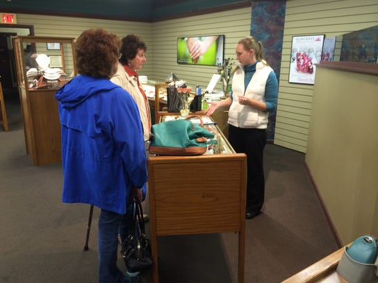 An employee at Lee Ayers Jewelers talks with a customer