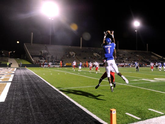 Cooper High School wide-receiver Myller Royals catches the game-winning pass at the end of Friday night's football game against Grapevine High School Sept. 8, 2017.